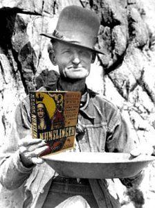 Gold prospecter holding a copy of Stark Holborn's Nunslinger
