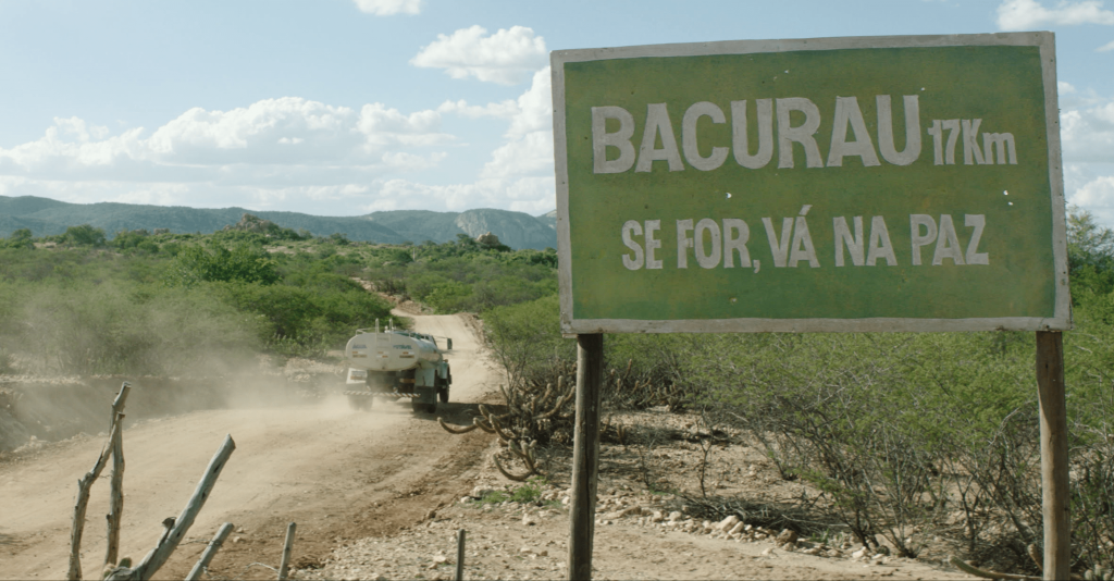 Still from Bacurau showing town sign